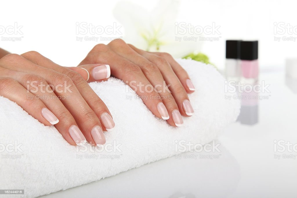 Manicured hands resting on a white towel royalty-free stock photo