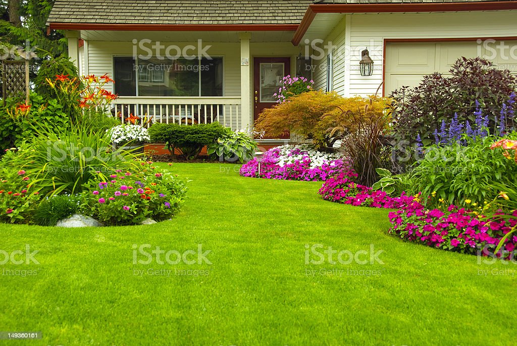 Manicured House and Garden stock photo