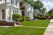 Beautifully landscaped residential neighborhood lawns with well-maintained homes.