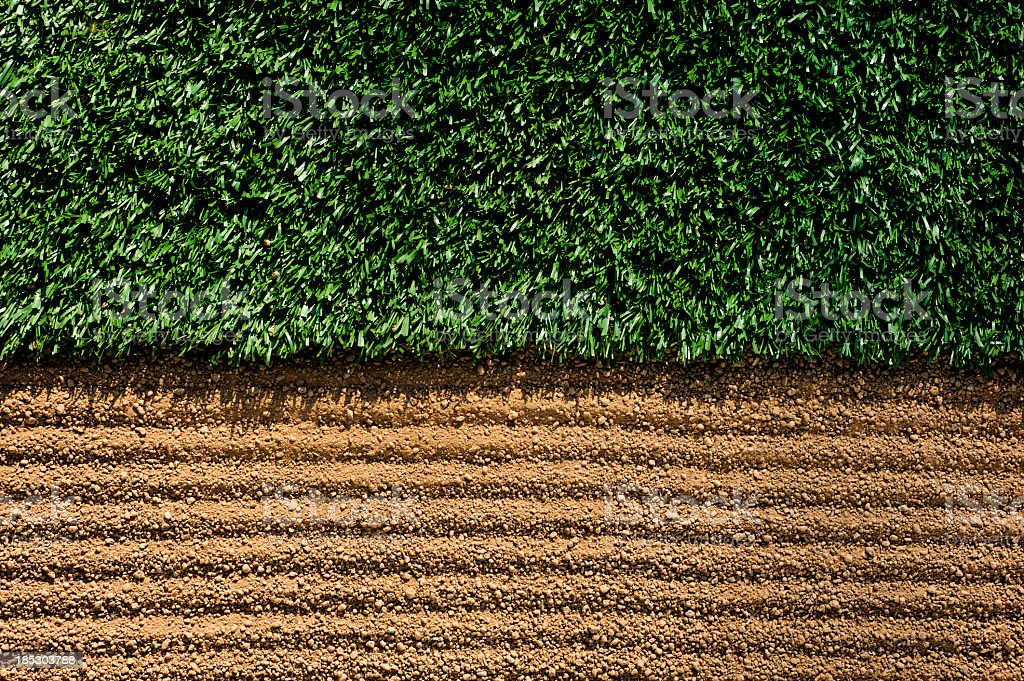 Manicured Sports Field between turf and dirt stock photo