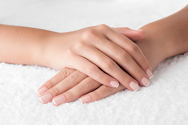 Manicured woman hands stock photo