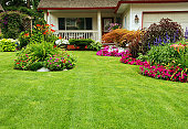 A finely manicured yard shows its summer colours.
