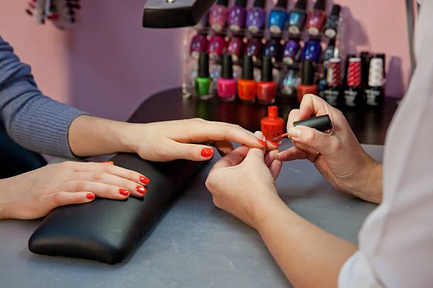 manicure,nail varnish red - nailstudio stock-fotos und bilder