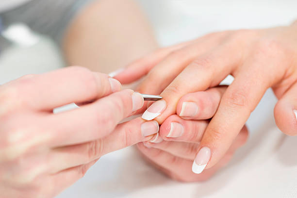 manicuring hands - cuticle stock pictures, royalty-free photos & images