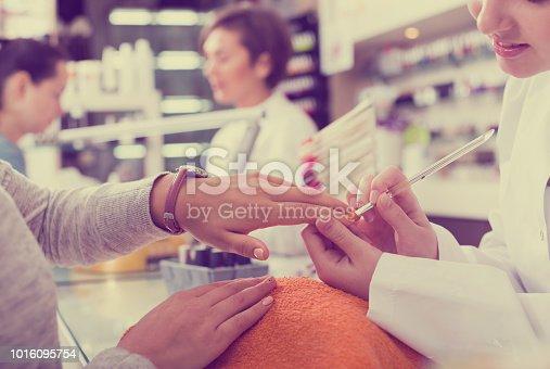 istock Manicurists giving manicure 1016095754
