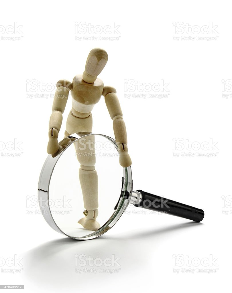 Manikin and magnifier royalty-free stock photo