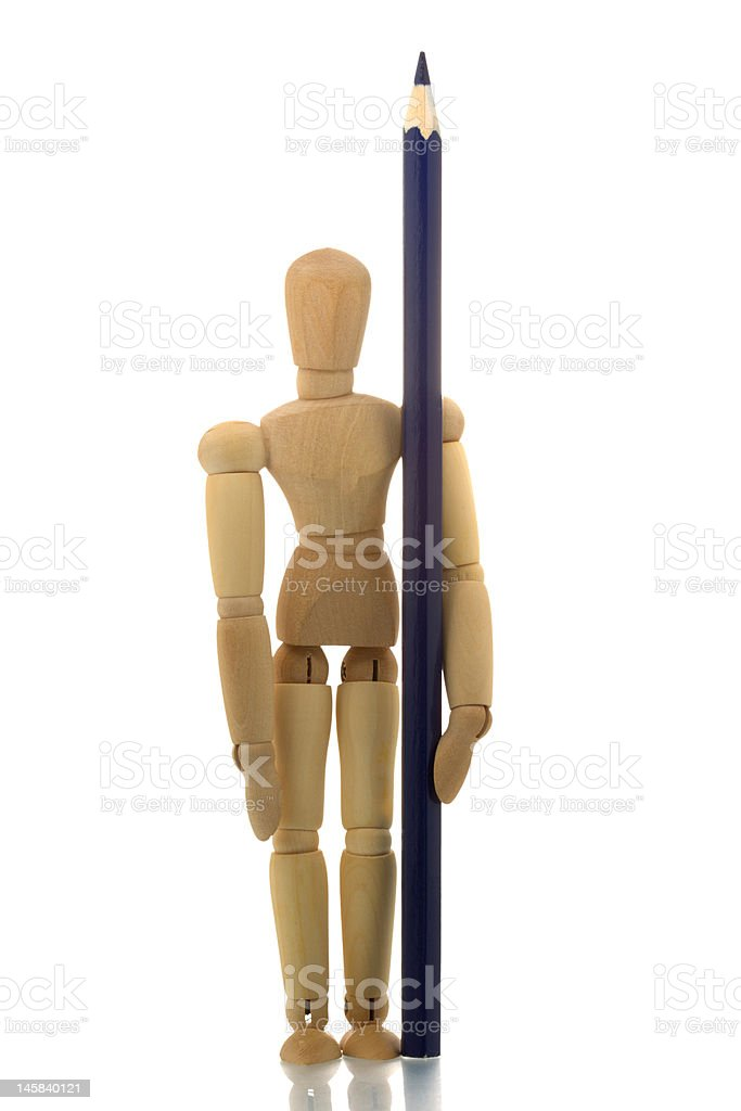 Manikin standing with blue pencil royalty-free stock photo