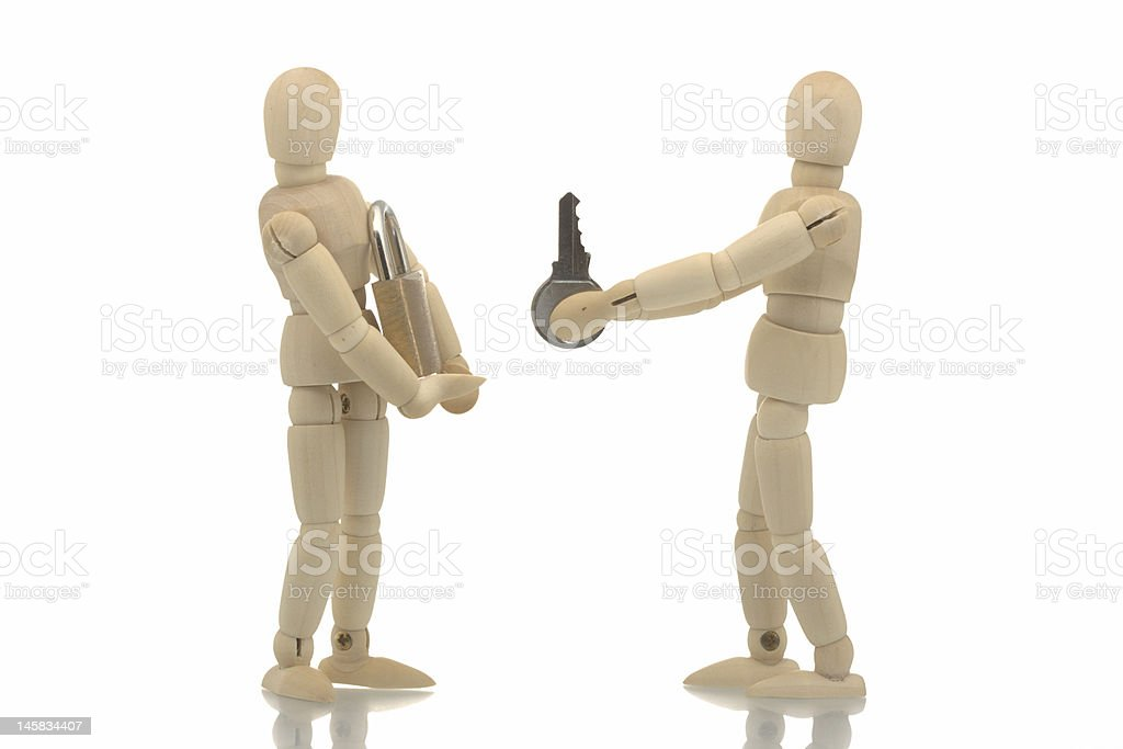 Manikins with lock and key royalty-free stock photo