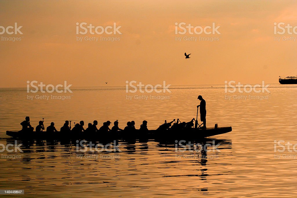 manila bay sunset rowers royalty-free stock photo