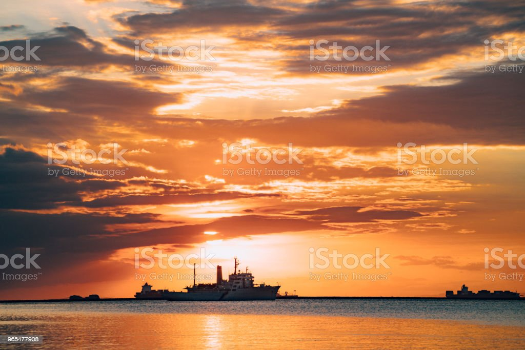 Manila Bay with Ship at Sunset in the Philippines stock photo
