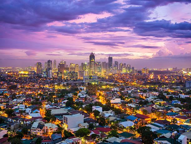 manila city at twilight showing bonafacio global city, ortigas - urban sprawl stock photos and pictures