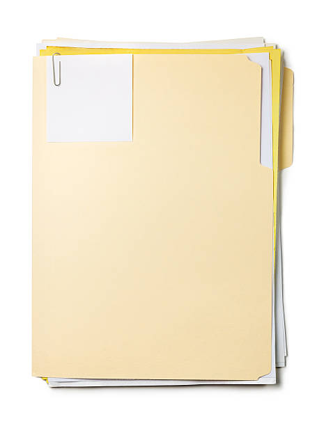 Manila folder with documents, sticky note and paper clip stock photo
