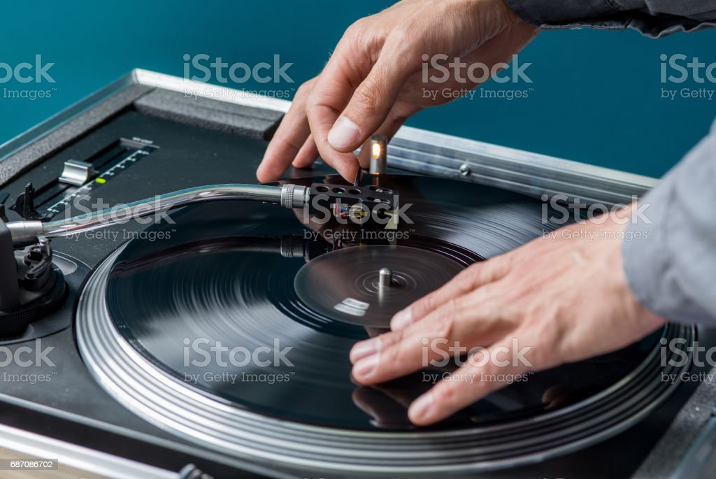 DJ manipulate with Record and Turntable Tonearm, Scratching stock photo