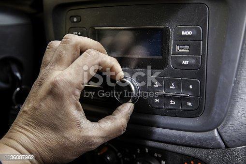 istock Manipulating the air conditioner 1136087962