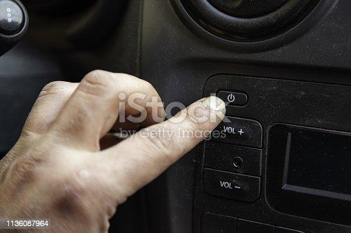 istock Manipulating the air conditioner 1136087964