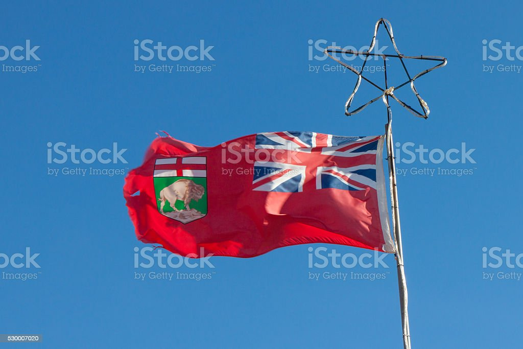 Manitoba Provincial Flag Against Blue Sky stock photo