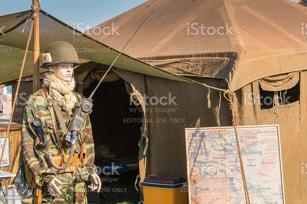 mannequin dressed in military front of a tent royalty-free stock photo