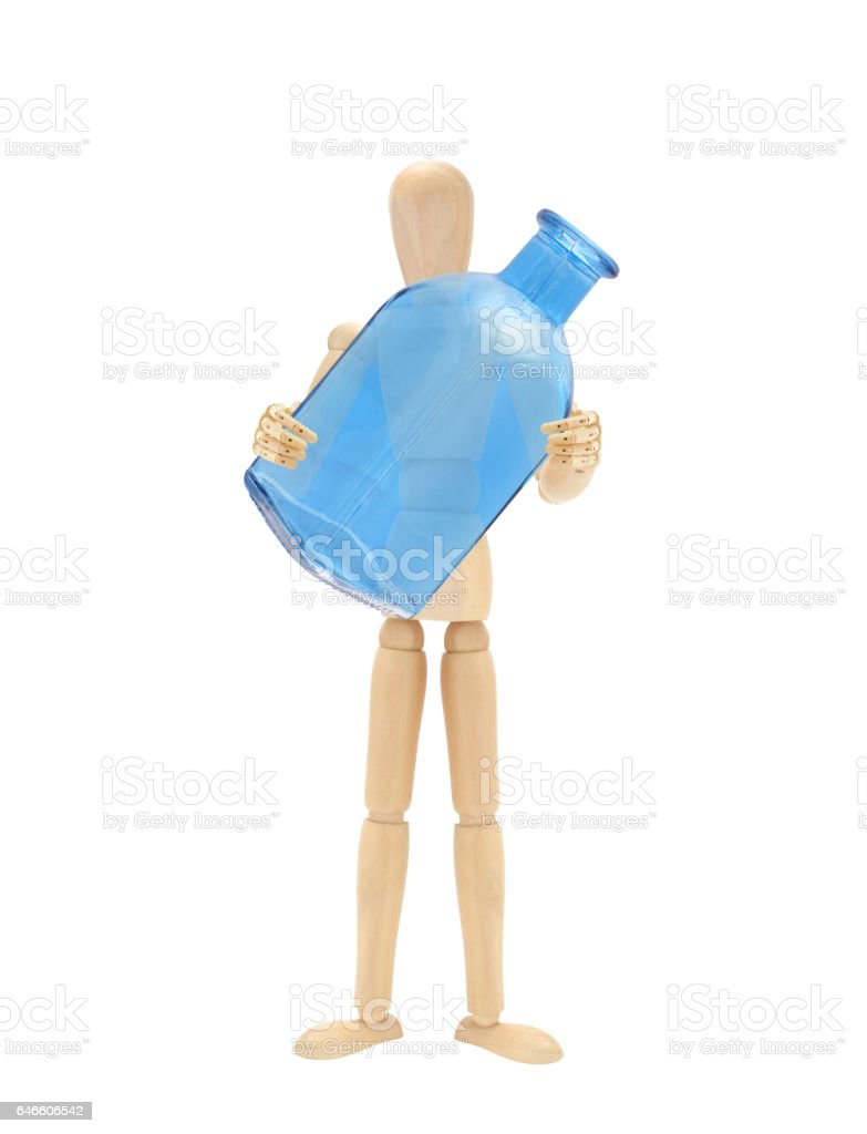 Mannequin holding empty blue bottle stock photo
