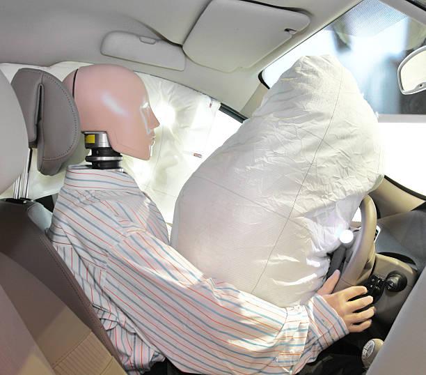 Schaufensterpuppe in ein Auto – Foto
