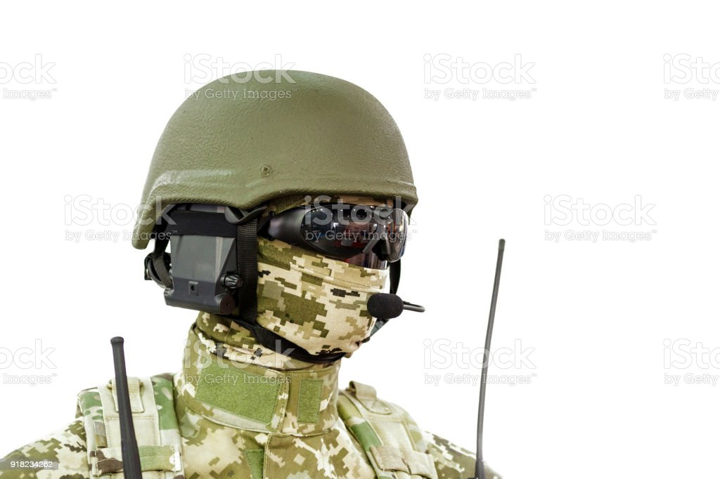 Mannequin in army uniform and equipment. Safety helmet and goggles. Special  'r'n radio communication device. Modern warfare facilities. Isolated on white. stock photo