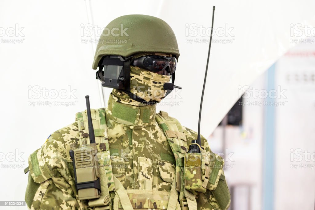 Mannequin in army uniform and equipment. Safety helmet and goggles. Special  'r'n radio communication device. Modern warfare facilities stock photo