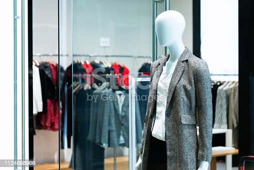 Mannequin in modern clothing store.