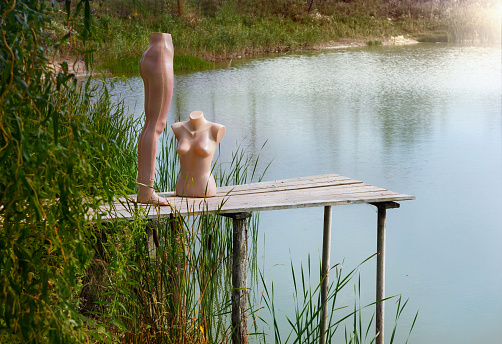 Mannequin in the role of people in the nature near the reservoir