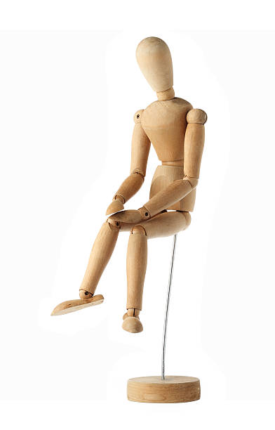 mannequin old wooden dummy feeling sad isolated on white mannequin old wooden dummy feeling sad isolated on white ventriloquist's dummy stock pictures, royalty-free photos & images