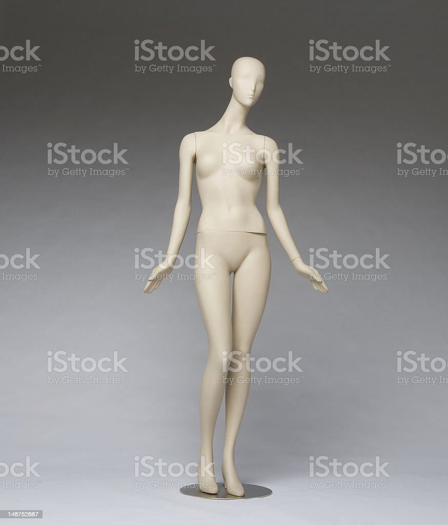 Mannequin on gray paper stock photo