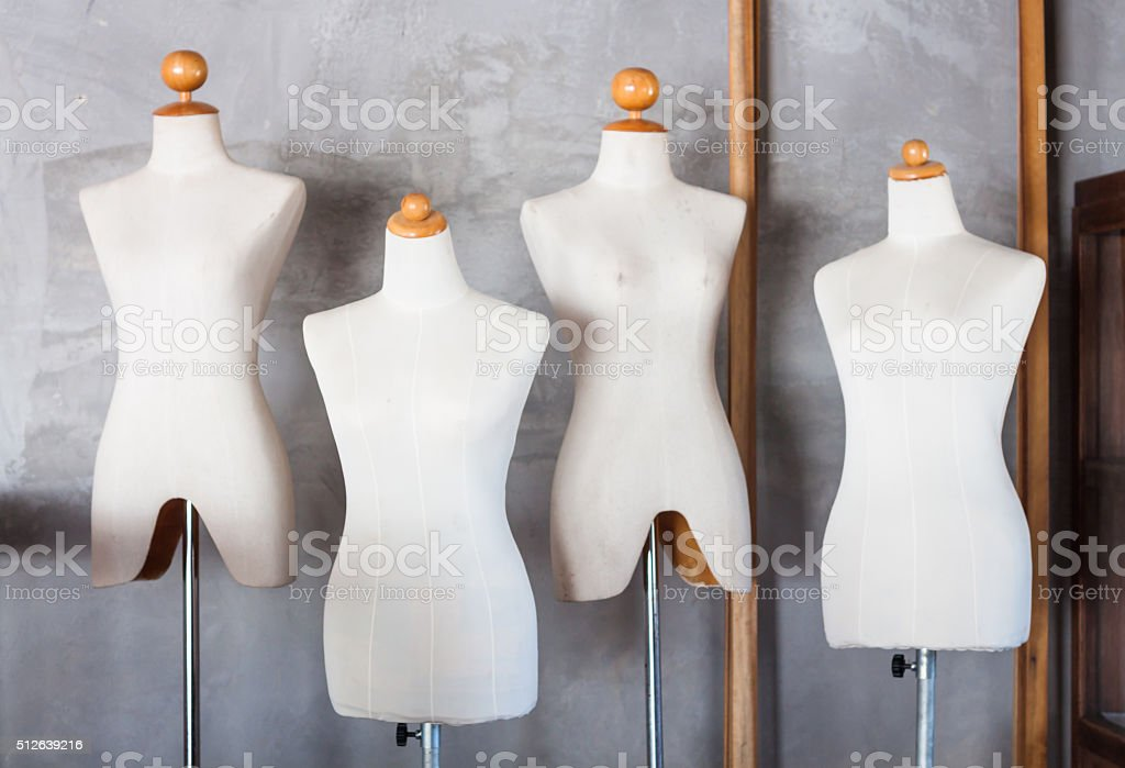 Mannequin tailors in storage room stock photo