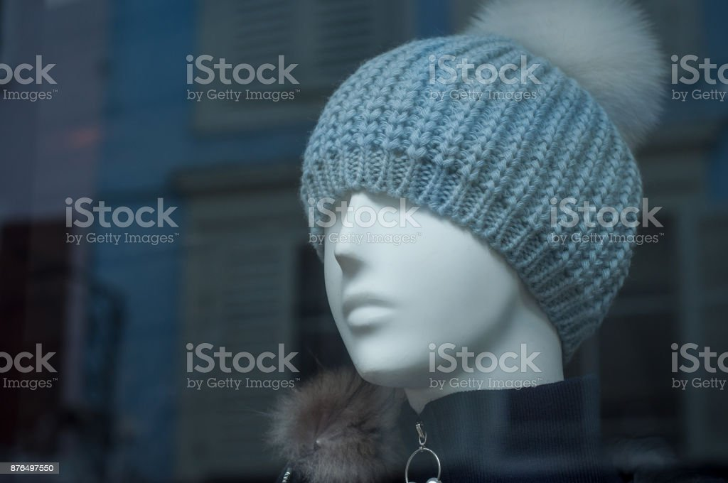 e78c4dc823f mannequin with winter hat in fashion store showroom royalty-free stock photo