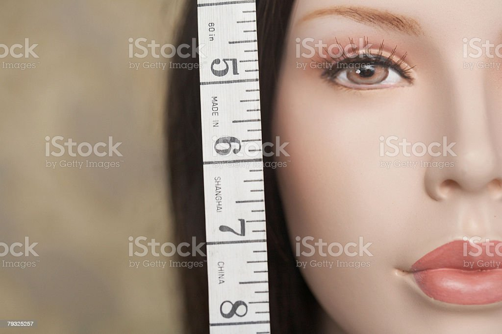 Mannequins face and a tape measure royalty-free 스톡 사진