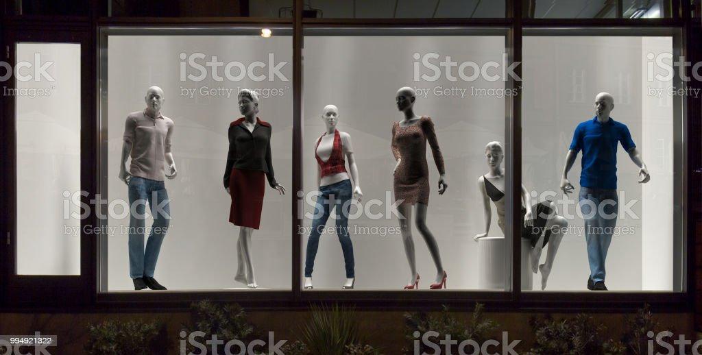 Mannequins in fashion shop, display window, interior design stock photo