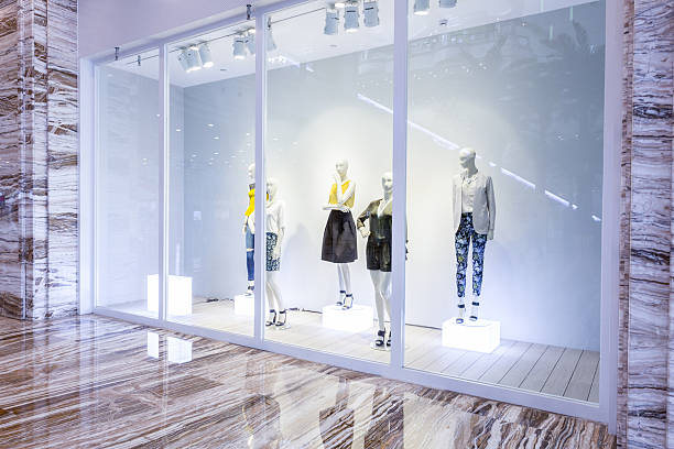 mannequins in fashion shop display window - store window stock pictures, royalty-free photos & images