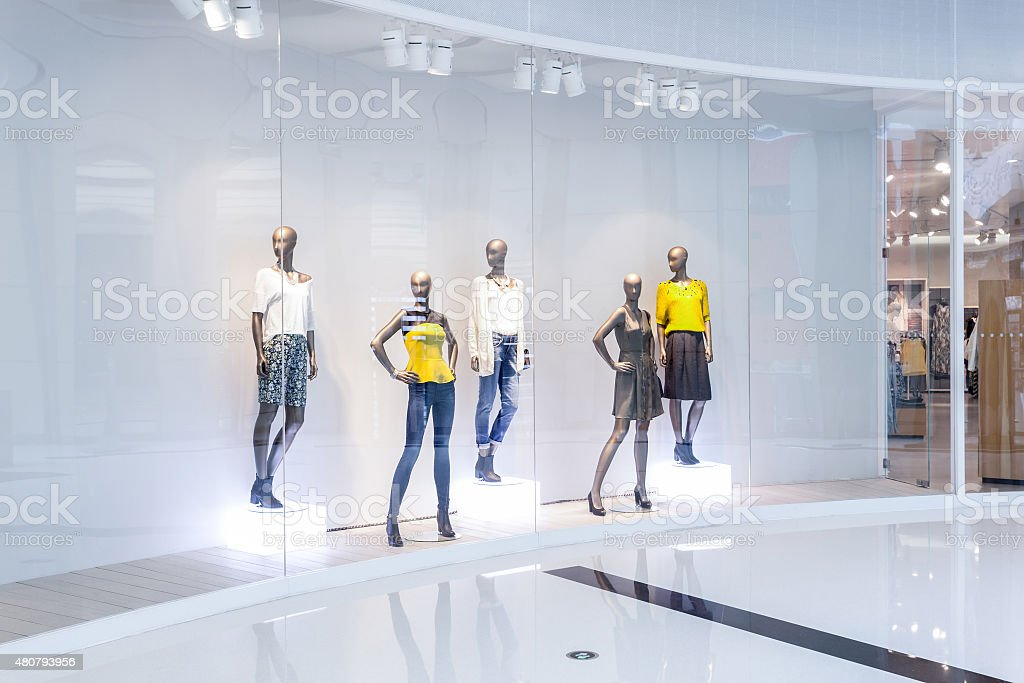 Mannequins in fashion shopfront stock photo
