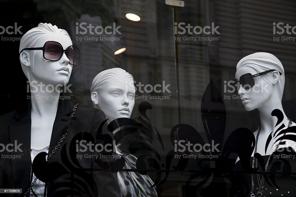 Mannequins in the shop window stock photo