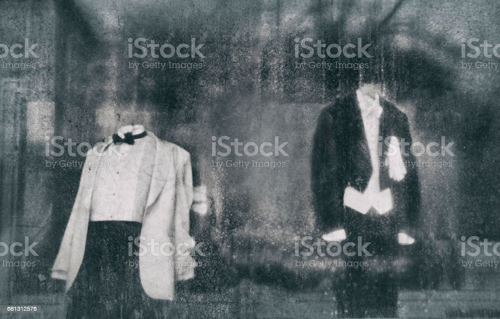 mannequins in the window behind dirty glass stock photo