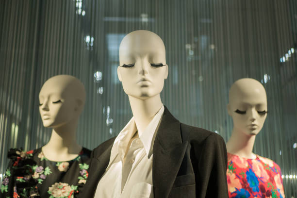 Mannequins with clothes and dresses display in the fashion store. stock photo