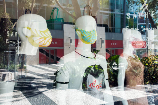 Mannequins with face masks stock photo