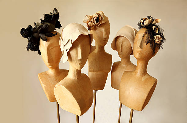 Mannequins with  funky design hats stock photo