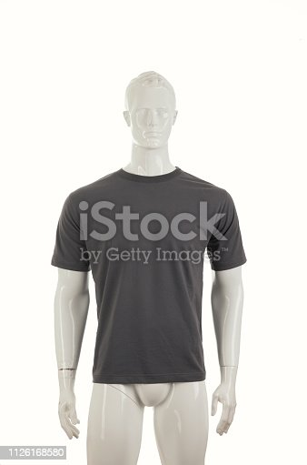 Mannequins with grey shirt, isolated on white