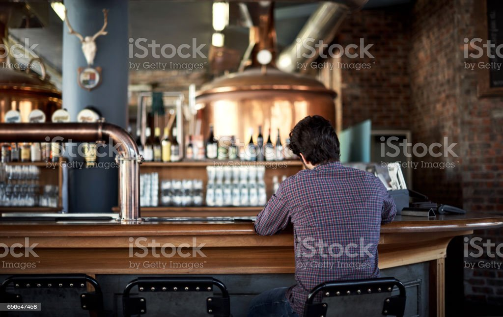 Manning the bar stock photo