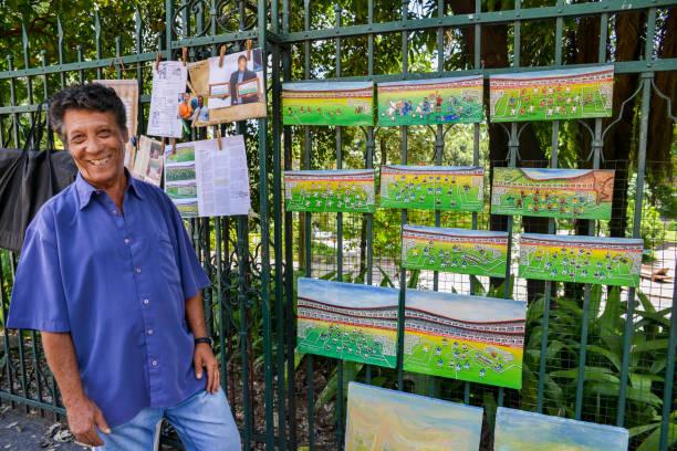 manoel francisco lopes de faria next to his paintings depecting - ronaldo imagens e fotografias de stock