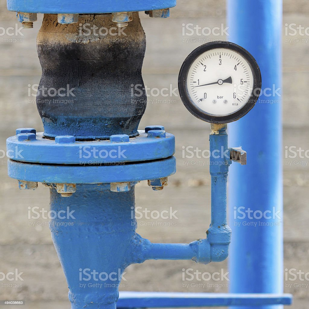 Manometer on blue pipe stock photo