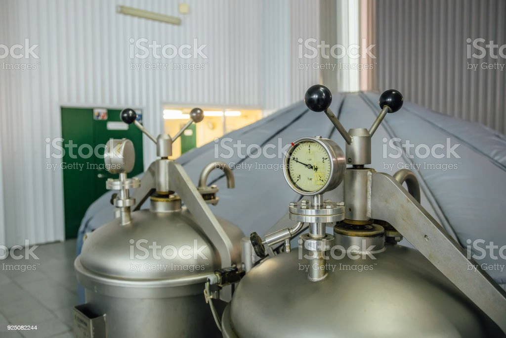 Manometer on the cylinder with gas in modern brewery. Close-up view stock photo