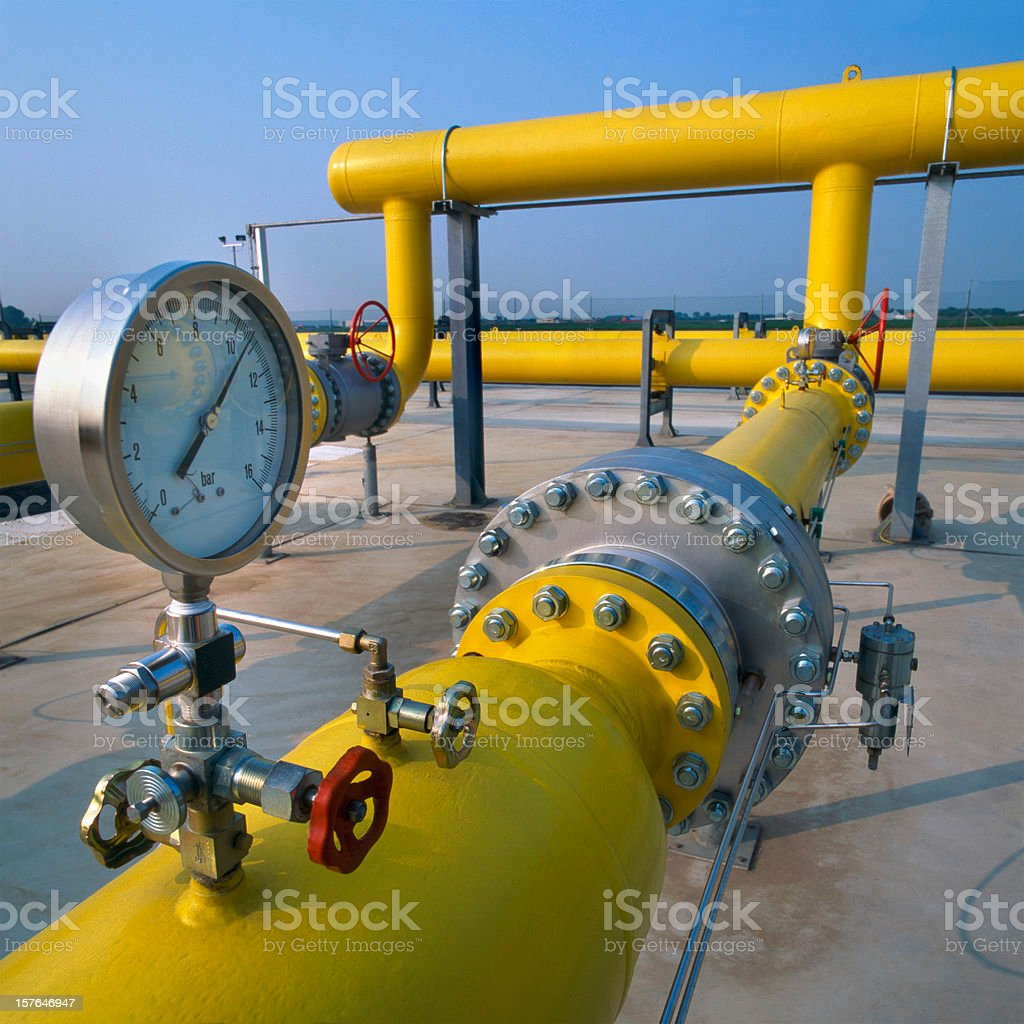 Manometer on yellow pipes in a gas distribution station royalty-free stock photo