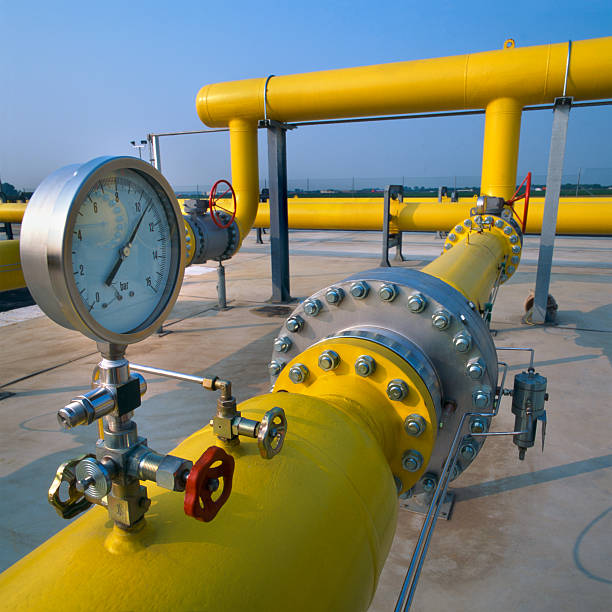 Manometer on yellow pipes in a gas distribution station stock photo