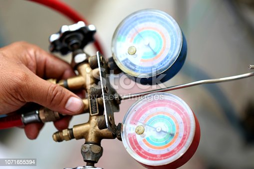 962280084 istock photo manometers measuring equipment for filling air conditioners,gauges. 1071655394