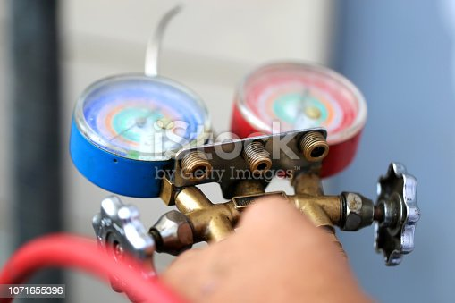 962280084 istock photo manometers measuring equipment for filling air conditioners,gauges. 1071655396