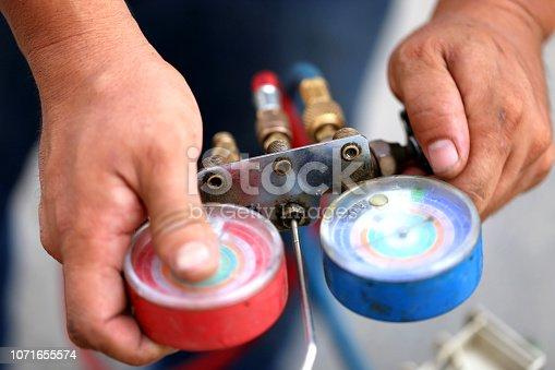 962280084 istock photo manometers measuring equipment for filling air conditioners,gauges. 1071655574